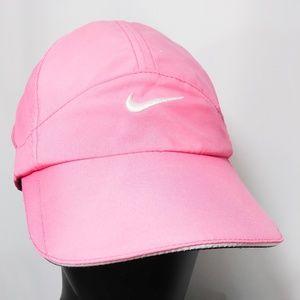 Pink Nike Drifit Featherlight hat. Adjustable back